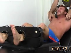 tied up hunk gets ticked and toyed by his partner