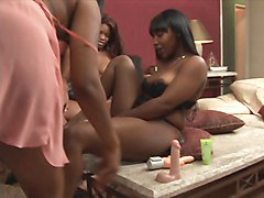 Black whore sticks huge dildo in her pussy