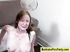 Bukkake slut blowjob and piss facial