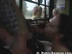 Sexy babe does a blowjob in a filled bus