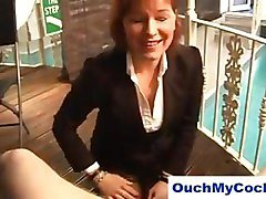 Cougar in business suit punishes guy for wanking