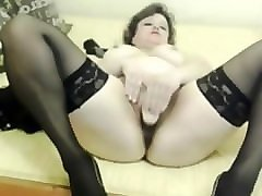 mature in stockings toys her pussy on cam