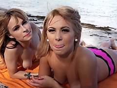 two hot bikini babes fucked by the shore