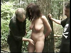 Hot Slave Tied To A Tree Gets Alot Of Clamps Removed From Her Big Tits And Master Spanks Her Tight Pussy
