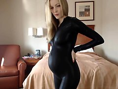 Pregnant in catsuit strip