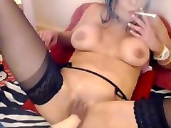 torrid big breasted nympho in black nylon stockings played with big toy
