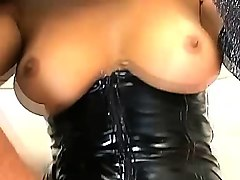 buxom brunette pamela carvalho shows off her perfect tits in a black leather corset while sucking a dick