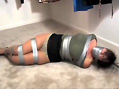 Milf gets tied and gagged at home with ductape